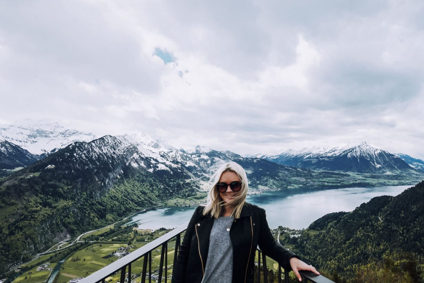 woman standing on overlook above Interlaken
